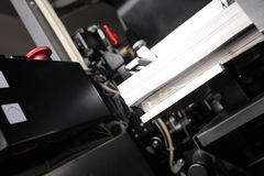 Printed products in offset machine Royalty Free Stock Photo
