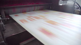 Printed red color on printing machine to make newspaper in factory stock video footage