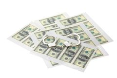 Printed sheets with dollars and handcuffs. Stock Photography
