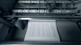 Printed sheets with text on a conveyor, top view. Sheets with text moving on a conveyor stock footage