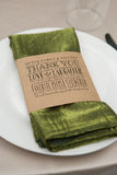 Printed Thank You Napkin Ring. On plate and at place setting at a wedding reception stock photo