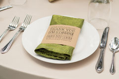 Printed Thank You Napkin Ring. On plate and at place setting at a wedding reception Stock Photography