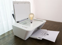 Printer with Bulb for idea Royalty Free Stock Photos