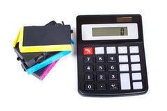 Printer cartridges and simple calculator Royalty Free Stock Photography