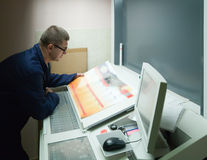 Printer checking a print run Royalty Free Stock Images