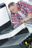 Printer checking print run at table stock photos