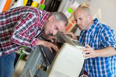 Printer checks quality machine while printing. Printer checks the quality of his machine while printing Royalty Free Stock Photos