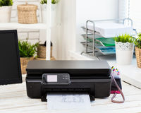 Printer. And computer. Office table stock image