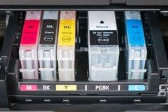 Printer ink cartridges. Ink cartridges inside printer - open ink printer royalty free stock image