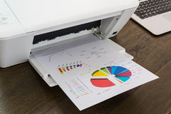 Printer and Laptop. On wood table royalty free stock photo