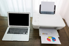Printer and Laptop. On wood table Stock Image