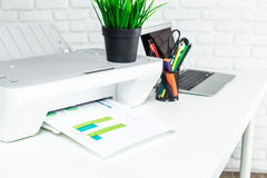 Printer, office interior. Printer on white office desk with office supplies Royalty Free Stock Photography