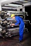 Printer operating printing machine. Professional printer operating modern industrial printing machine Royalty Free Stock Photos