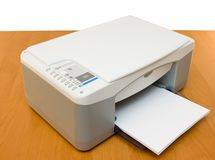 Printer placed on a wood table royalty free stock photo