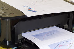 Printer printing business report. Printer prints business report on white background royalty free stock photography