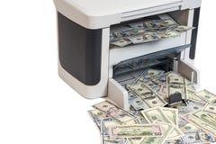Printer printing fake dollar bills Stock Photo
