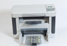Printer printing fake dollar bills  on white Royalty Free Stock Image