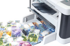 Printer printing fake Swiss francs, currency of switzerland Royalty Free Stock Photo