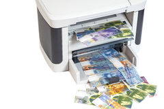 Printer printing fake Swiss francs, currency of switzerland Royalty Free Stock Images