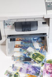Printer printing fake Swiss francs, currency of switzerland Stock Image