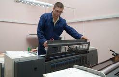 Printer working at offset machine Royalty Free Stock Photo