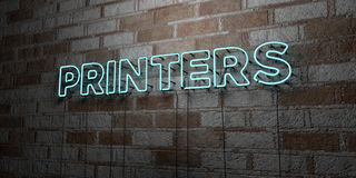 PRINTERS - Glowing Neon Sign on stonework wall - 3D rendered royalty free stock illustration. Can be used for online banner ads and direct mailers Royalty Free Stock Image