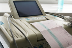 Printing of cardiogram report coming out from Electrocardiograph in labour ward Stock Photography