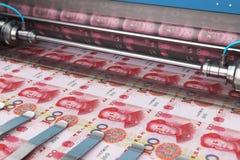 Printing 100 Chinese yuan money banknotes. Business success, finance, banking, accounting and making money concept: printing 100 Chinese yuan money paper cash royalty free illustration
