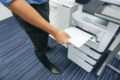 Printing document. A man is printing document  copy a document Stock Photos