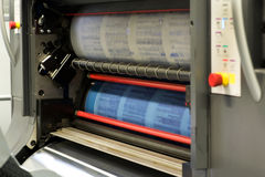 Printing Documents Using Rotary Press Machine. Printing Plenty of Documents or Papers Using Rotary Printing Press Machine royalty free stock photography