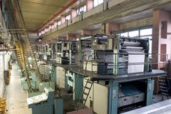Printing house. Different printing machines and polygraphic equipment stock image