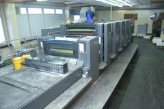 Printing house. Different printing machines and polygraphic equipment stock photo