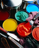 Printing inks. Cans of printing inks with ink knives and wipers royalty free stock image