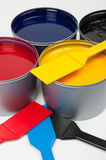 Printing inks. (cmyk) and trowels on grey background royalty free stock photography