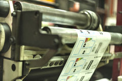 Printing labels on offset machine. Printing at high speed on offset machine. Label, Rolled Up, Printing Out, Group of Objects, Merchandise Royalty Free Stock Photo