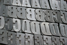 Printing letters. Close up of metal printing letters Stock Photos