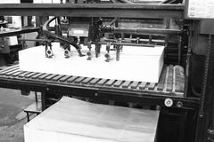 Printing Machine. An old offset printing machine in black and white stock photo