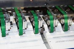 Printing machine:digital presse. Part of printing machine carrying sheets Royalty Free Stock Photos