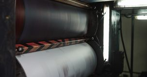 Printing machine. Large paper roll print machine in production.  stock footage