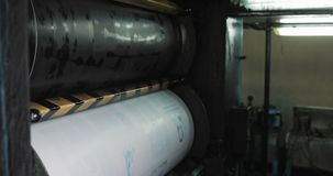 Printing machine. Large paper roll print machine in production.  stock video footage