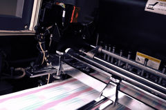 Printing machine during production output Stock Photos