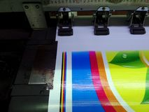 Printing media on large printer. Colorful and bright printed on Polyvinyl, PVC Royalty Free Stock Images