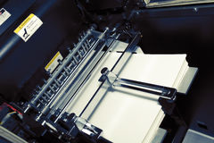 Printing offset machine with a stack of paper Royalty Free Stock Photo