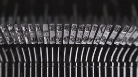 Printing on old typewriter. Printing on an old typewriter, the secretary prints annual reports stock video