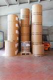Printing paper rolls. Big pile of printing paper rolls in warehouse stock images