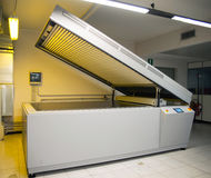 Printing plant - Flexographic printing plates. Printing Plant - Machine for exposing flexographic printing plates with UV-A LEDs royalty free stock photo