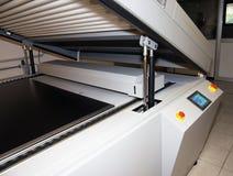 Printing plant - Flexographic printing plates. Printing Plant - Machine for exposing flexographic printing plates with UV-A LEDs stock photo
