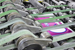 Printing plant magazine line binding process, convayer belt Stock Image