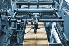 Printing press. Detail of a printing machine in production Stock Images