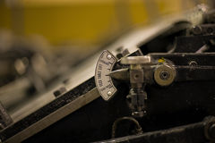 Printing Press. Detail of ancient old printing press with shallow depth of field royalty free stock photos